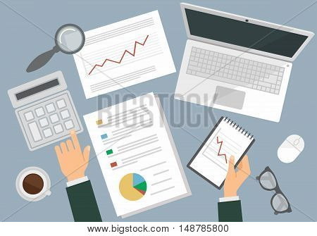 Business people working a on a desk top view with computer, calculator and stationery