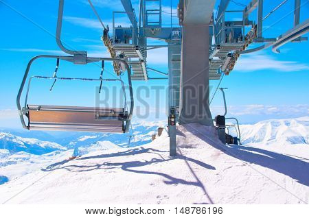 Cable lift on high peak of ski and snowbord resort. Extreme health life concept. Snowy high point on big mountain in winter season.