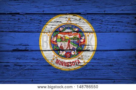 Minnesota US State grunge wood background with Minnesotan flag painted on aged wooden wall.