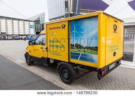 HANNOVER GERMANY - 23 2016: New electric mail delivery van from the Deutsche Post DHL at the IAA Commercial Vehicles 2016 International Trade Fair