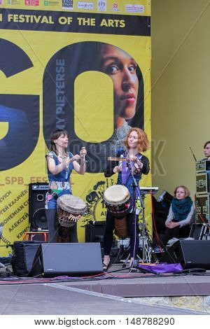 St. Petersburg, Russia - 13 August, Musicians with African drums between their legs,13 August, 2016. Africa and the Russian Culture Festival on Krestovsky Island in St. Petersburg.