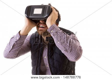Young man experiencing virtual reality through a VR headset isolated on white background