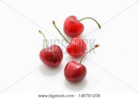 Ripe red cherry berries isolated on white background.