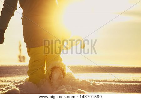 Snowboarder goes in snowdrift on the sunlight horizon background. Sheregesh