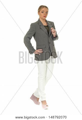 Studio Shot Of A Large Woman In White Trousers
