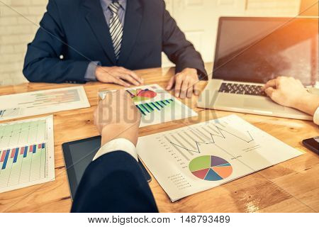 business partners in suit discussing documents and ideas at meeting Business concept soft focus vintage tone
