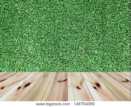 perspective wooden floor and grass wall background. for product display
