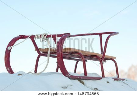 red sledge in the snow. Close up
