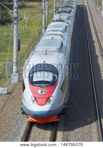 LENINGRAD REGION, RUSSIA - JULY 17, 2015: Top view of the approaching high speed train