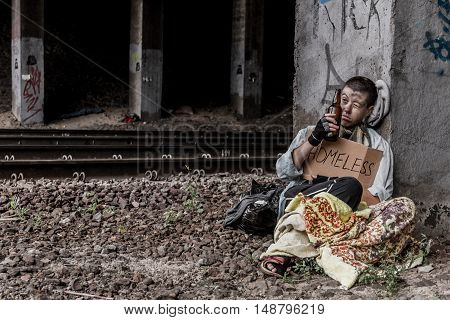 Homeless Woman Near The Rail Track