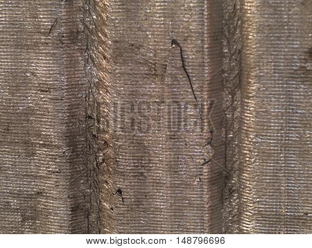 decayed corrugated tin foil sheet with scrathes and dirt