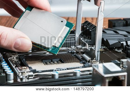 CPU in hand before installation into the motherboard