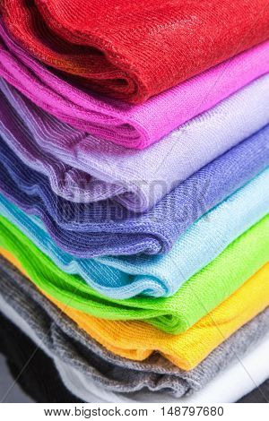 Textile colorful socks background. colorful background. Green, pink, red, blue yellow and other colors
