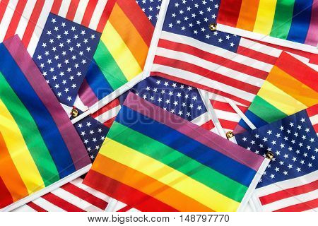 flags of the LGBT community on a background of the American flag