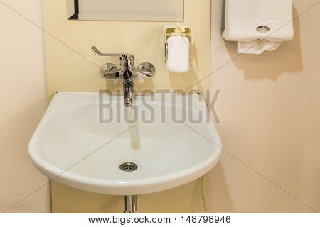 Washbasin With Soap Hand Sanitizer And Tissue Paper