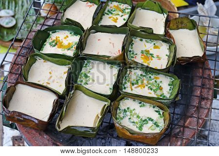 Thai North omelette style and Banana leaf containers on the gril