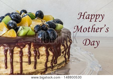 Beautiful greeting card mother's day (half cake with fruits)