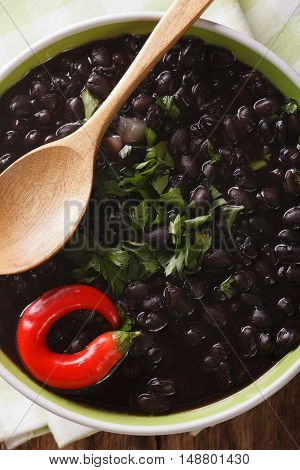 Thick Soup Of Black Bean With Chilli Peppers Close Up In A Bowl. Vertical Top View