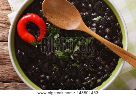 Thick Soup Of Black Bean With Chilli Peppers Close Up In A Bowl. Horizontal Top View