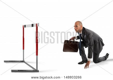 Businessman ready to race looks an obstacle
