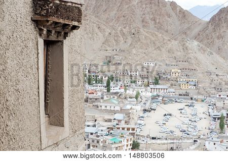 Tibetan Styled Window With Leh Ladakh Cityscape In Background
