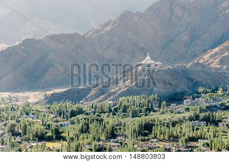 Nature and mountain landscape with stupa monastery on top of hill - in Leh Ladakh India.