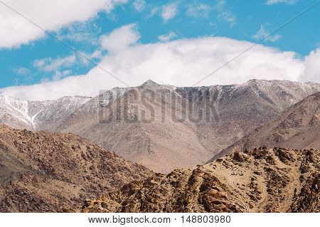 Top Of Rock Mountain In Blue Cloud Sky - With Copyspace In Leh, Ladakh, India