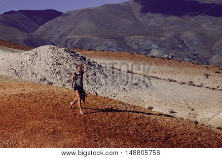 Fashion Portrait Of Running Woman In Colorful Mountains
