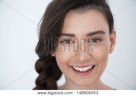skin and hair care concept, portrait of a young pretty woman with freckles