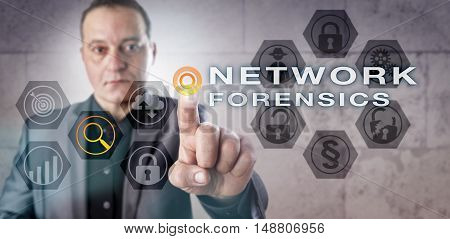 Experienced computer investigator with cautious look analyzing a NETWORK FORENSICS scenario onscreen. Information security and law enforcement metaphor for computer networking and digital forensics.
