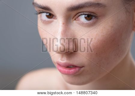 skin care concept, close up of a young pretty girl face with copy space