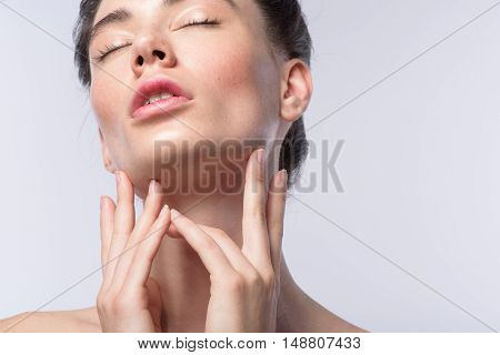 skin care concept, face of a relaxed woman with closed eyes and copy space