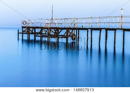 A large cloud of misty an empty dock in the morning