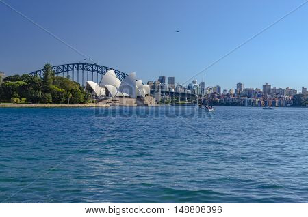 SYDNEY, AUSTRALIA - AUGUST 02, 2014: The harbour of Sydney with the opera building and the harbour bridge.