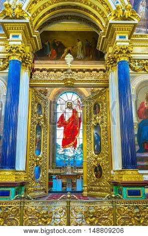 SAINT PETERSBURG RUSSIA - APRIL 25 2015: The altar of St Isaac's Cathedral decorated with the stained-glass window depicting Jesus Christ blessing the worshipers on April 25 in Saint Petersburg.