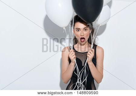 young surprised girlfriend standing on white background with copy space
