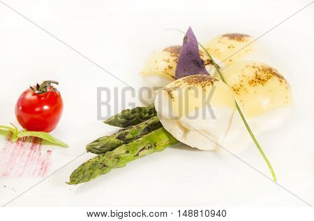 meat cutlets with asparagus on a table in a restaurant