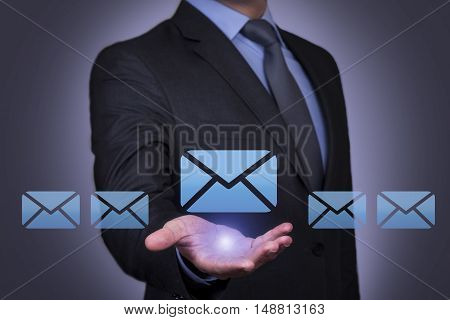 Human Holding his Hand Above the Mail Working Conceptual Business Concept
