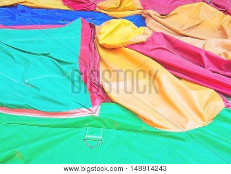 Plastic colorful protective covers closeup in green orange blue red yellow for copy space background.