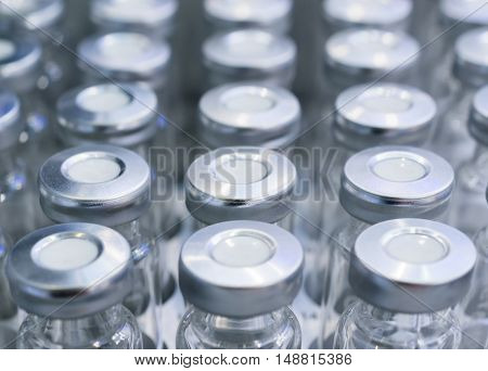 Glass vials for liquid samples. Shallow depth of field.