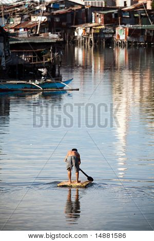 Man On Raft - Squatter Shanty Area