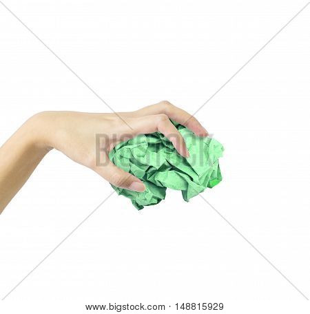 Closeup action of woman hand catching green crumpled paper in hand isolated on white background