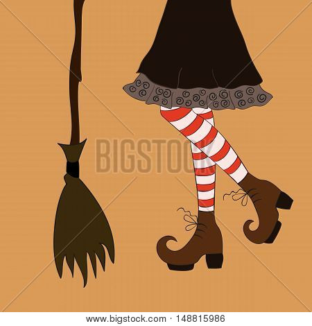 Halloween closeup witch legs in boots and with broomstick.