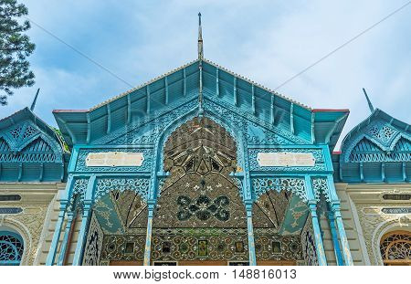 The scenic balcony of Firuza Persian Palace decorated with stellar and floral patterns of painted details and mirror tiles Borjomi Georgia.