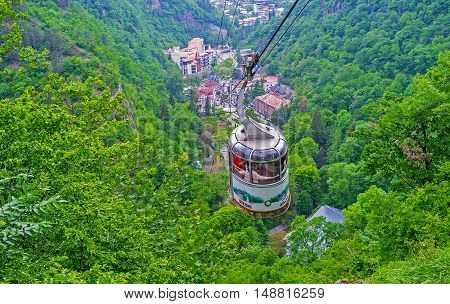 BORJOMI GEORGIA - MAY 27 2016: The cableway is the best choice to overlook the sites of Nature Reserve of Borjomi-Kharagauli on May 27 in Borjomi.