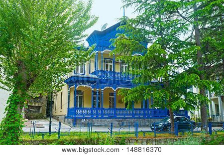 The traditional mansion with carved wooden terraces on the facade Borjomi Georgia.