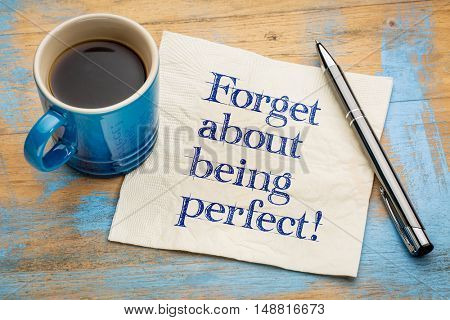 forget about being perfect - advice or reminder - handwriting on a napkin with a cup of coffee