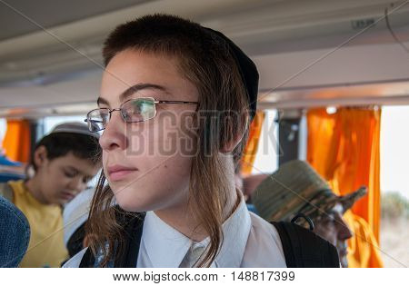 ISRAEL - SEPTEMBER 24 2010: Orthodox Jewish boy in the bus. Israel