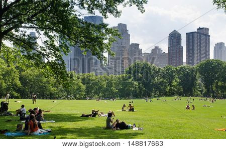 CENTRAL PARK NEW YORK USA - JUNE 10 2015: New York citizens and tourist relax at Central Park