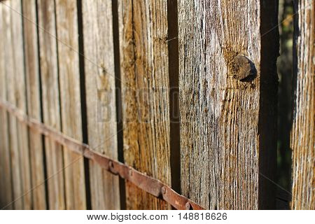 wooden brown fence in the sun, country fence
